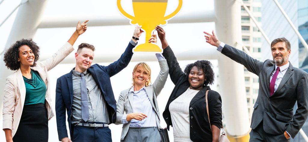 Entrepreneurs holding a cardboard trophy