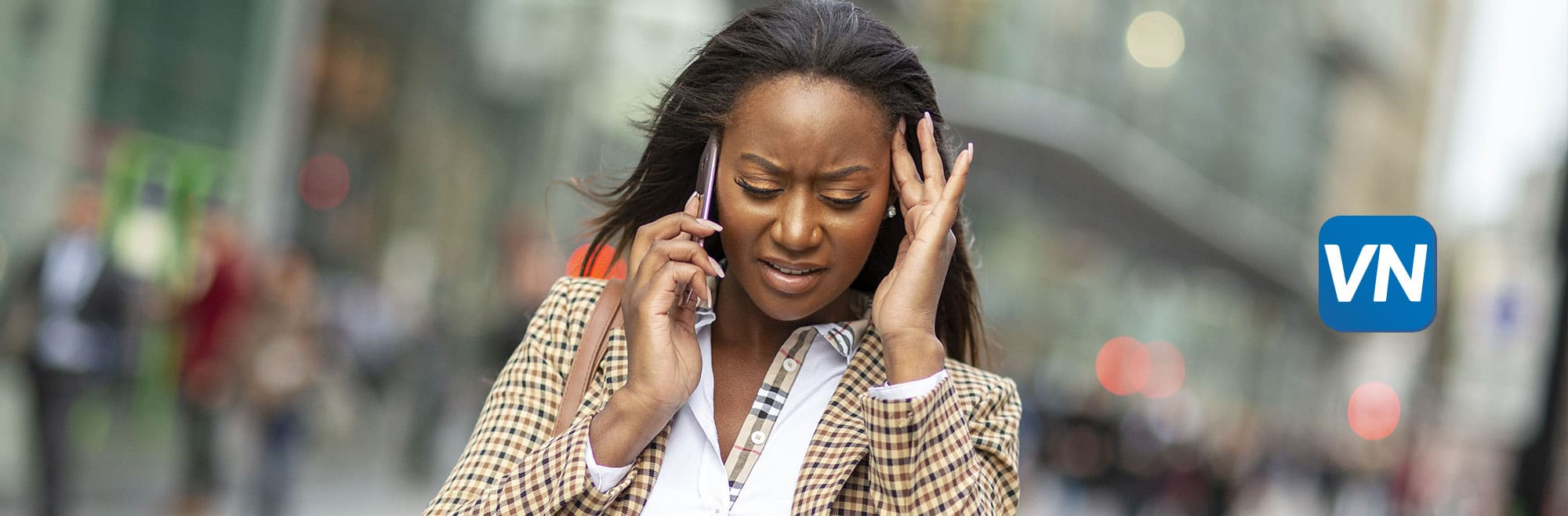 Woman on the phone trying to hear the other person